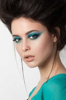 Young brunette woman in a turquoise dress