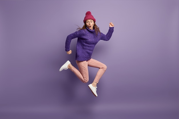 Young brunette woman wearing purple sweater