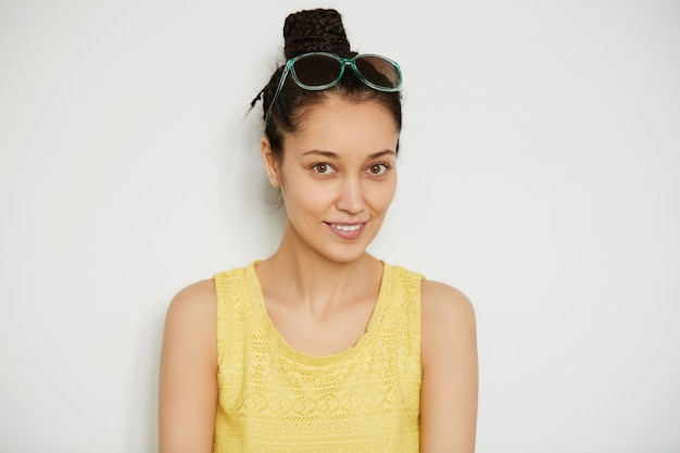 Young brunette woman with hair in a bun