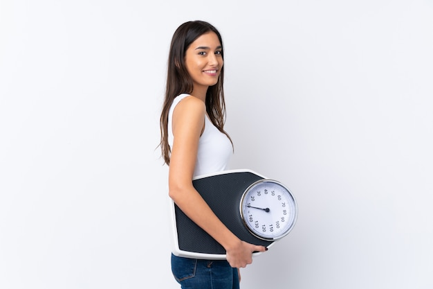 Young brunette woman with weighing machine