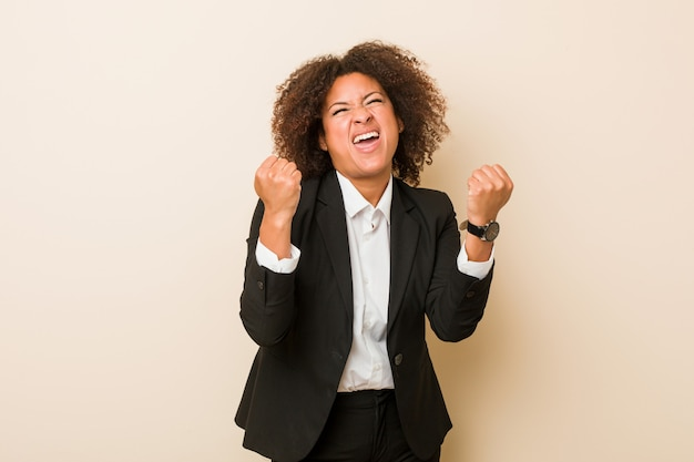 Young business african american woman cheering carefree and excited. victory concept.