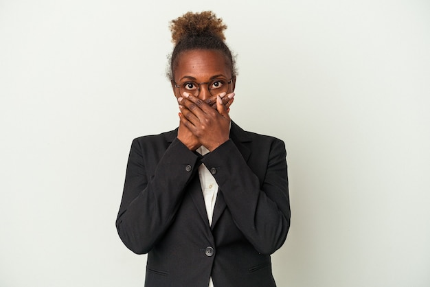 Young business african american woman isolated on white background shocked covering mouth with hands.