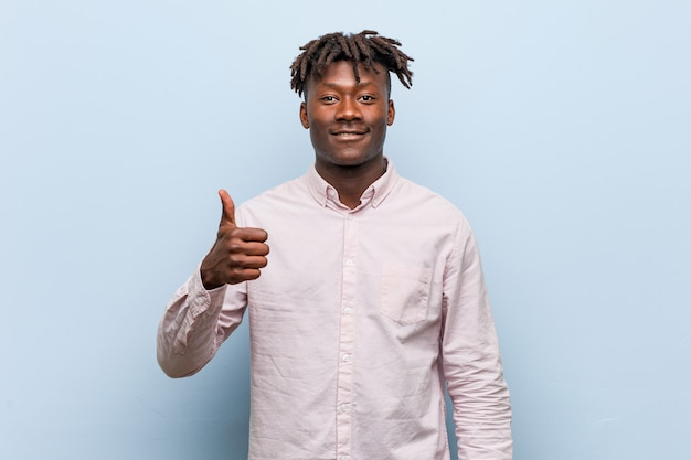 Young business african black man smiling and raising thumb up
