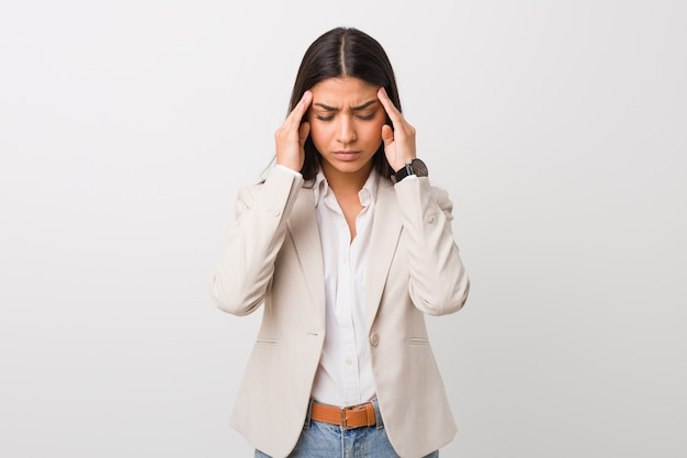 Young business arab woman isolated against a white background touching temples and having headache.