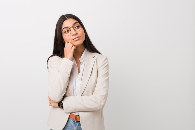 Young business arab woman isolated against a white background who feels sad and pensive, looking at copy space.