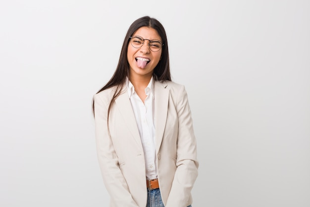 Young business arab woman isolated against a white  funny and friendly sticking out tongue.