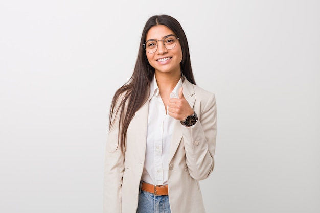 Young business arab woman smiling and raising thumb up