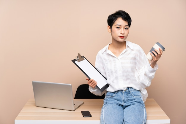 Young business asian woman in her workplace