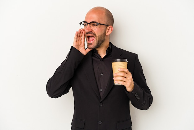 Young business bald man holding take away coffee isolated on white background  shouting and holding palm near opened mouth.