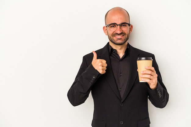 Young business bald man holding take away coffee isolated on white background  smiling and raising thumb up