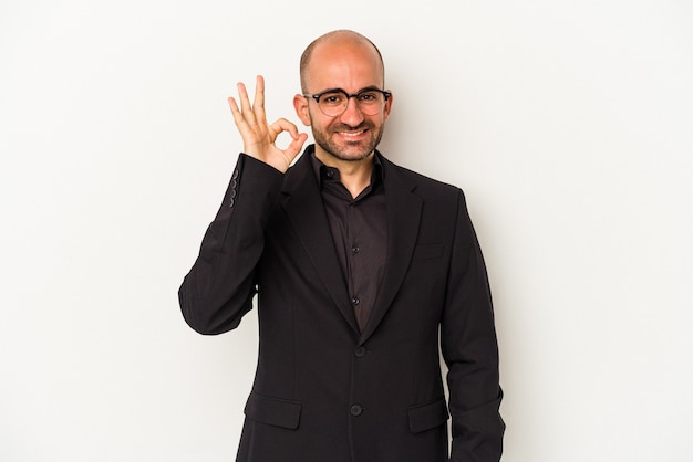Young business bald man isolated on white background  cheerful and confident showing ok gesture.