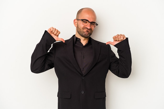 Young business bald man isolated on white background  feels proud and self confident, example to follow.
