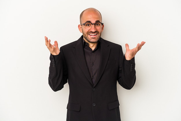 Young business bald man isolated on white background  receiving a pleasant surprise, excited and raising hands.