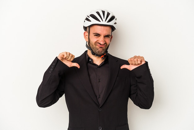 Young business bald man wearing a bike helmet isolated on white background  feels proud and self confident, example to follow.