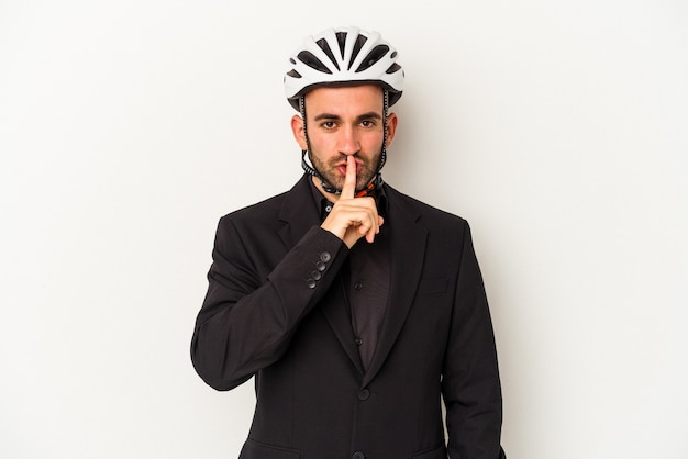 Young business bald man wearing a bike helmet isolated on white background  keeping a secret or asking for silence.