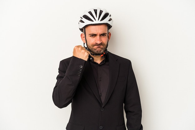 Young business bald man wearing a bike helmet isolated on white background  showing fist to camera, aggressive facial expression.