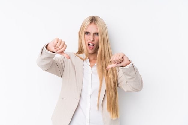 Young business blonde woman showing thumb down and expressing dislike.