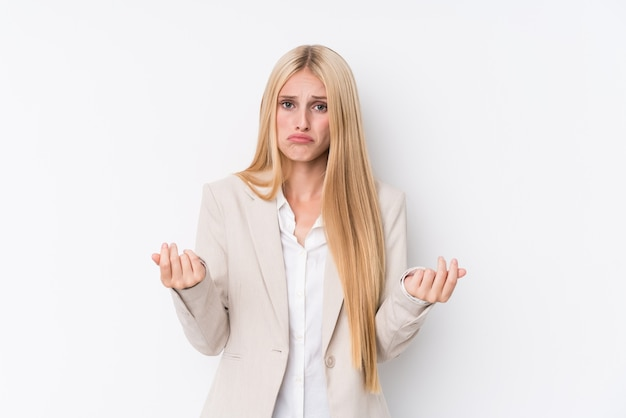 Young business blonde woman on white wall showing that she has no money