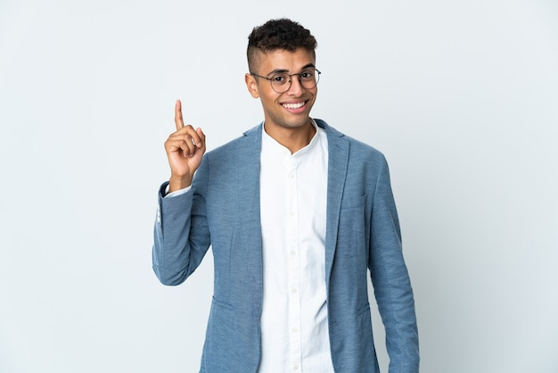 Young business brazilian man isolated on white wall showing and lifting a finger in sign of the best