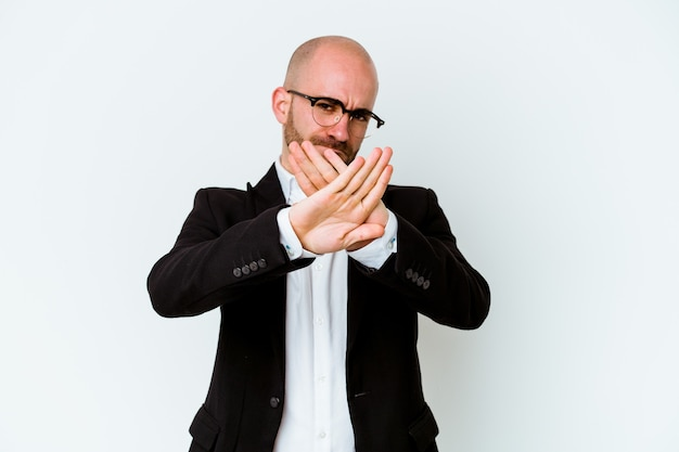 Young business caucasian bald man isolated on blue background doing a denial gesture