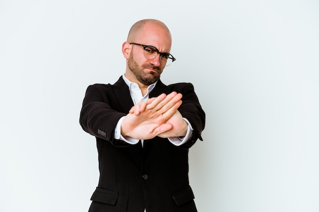 Young business caucasian bald man isolated on blue background standing with outstretched hand showing stop sign, preventing you.