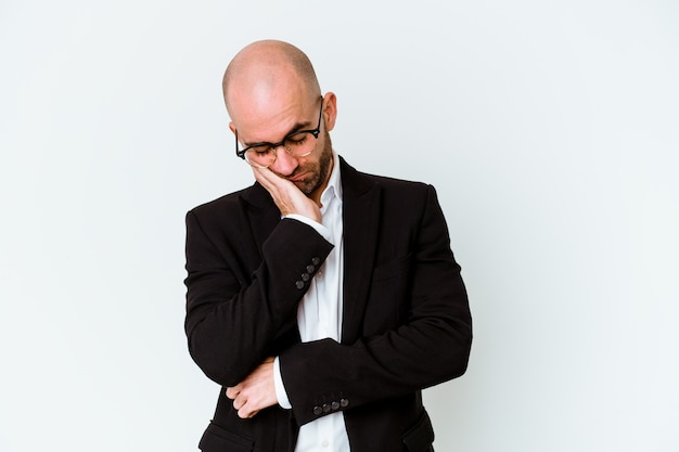 Young business caucasian bald man isolated on blue background who is bored, fatigued and need a relax day.