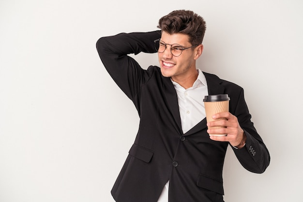 Young business caucasian man holding take away coffee isolated on white background touching back of head, thinking and making a choice.