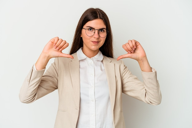 Young business caucasian woman isolated on white background feels proud and self confident, example to follow.