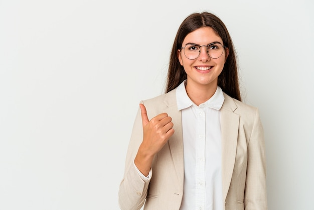 Young business caucasian woman isolated on white background smiling and raising thumb up