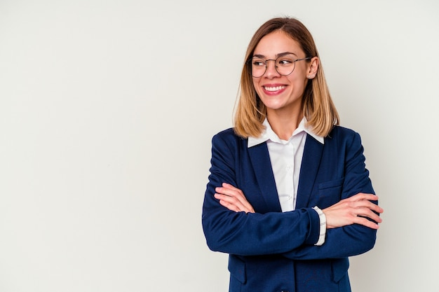 Young business caucasian woman isolated on white smiling confident with crossed arms.
