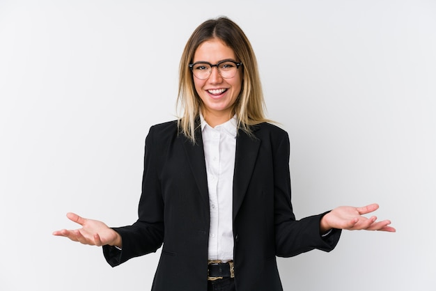 Young business caucasian woman showing a welcome expression.