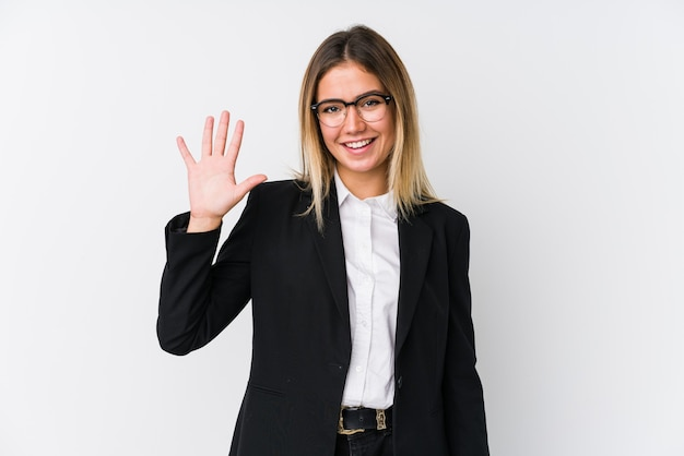 Young business caucasian woman smiling cheerful showing number five with fingers.