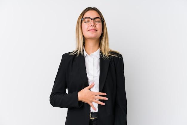 若いビジネス白人女性はおなかに触れる、優しく笑顔、食事と満足の概念。