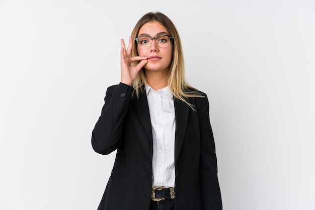 Young business caucasian woman with fingers on lips keeping a secret.