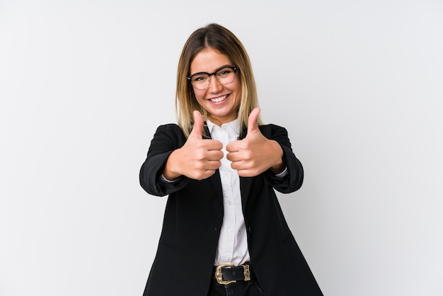 Young business caucasian woman with thumbs ups, cheers about something