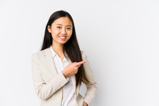 Young business chinese woman isolated smiling and pointing aside, showing something at blank space.