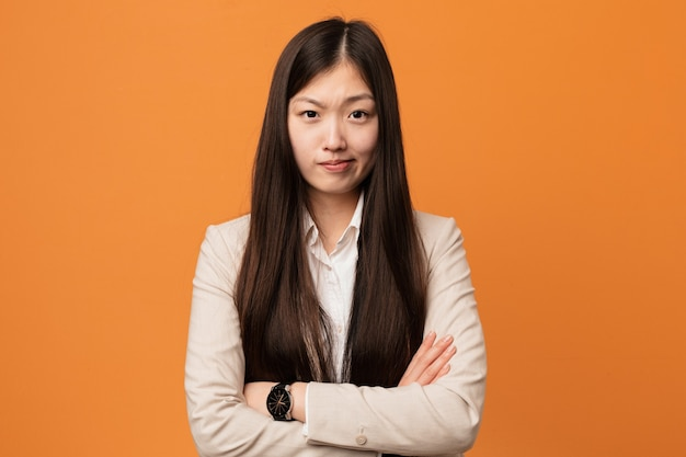 Young business chinese woman unhappy with sarcastic expression.