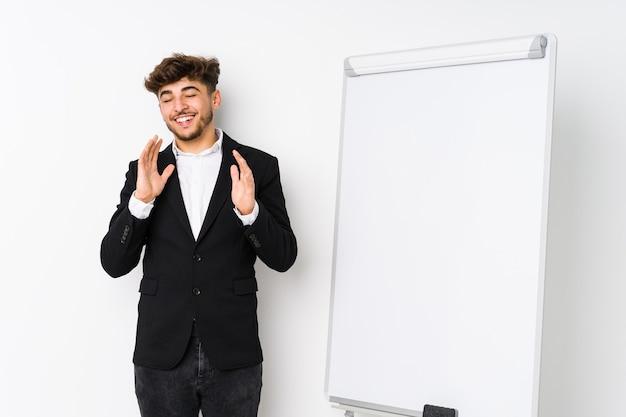 Young business coaching arabian man joyful laughing a lot