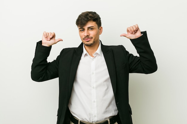 Young business hispanic man feels proud and self confident, example to follow.