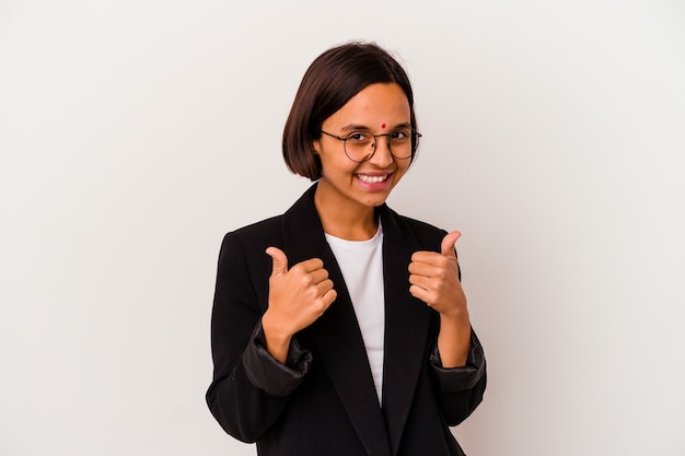 Young business indian woman isolated on white background raising both thumbs up, smiling and confident.