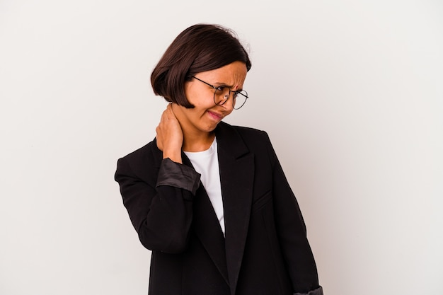 Young business indian woman isolated on white background suffering neck pain due to sedentary lifestyle.