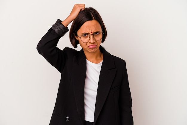Young business indian woman isolated on white being shocked, she has remembered important meeting.