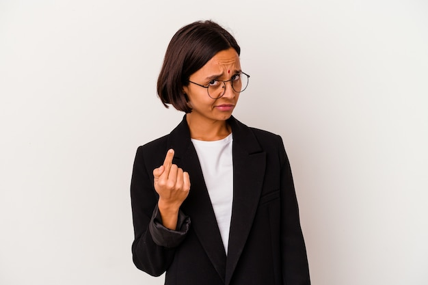Young business indian woman isolated on white pointing with finger at you as if inviting come closer.