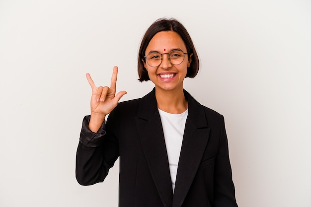 Young business indian woman isolated on white wall showing a horns gesture as a revolution concept.