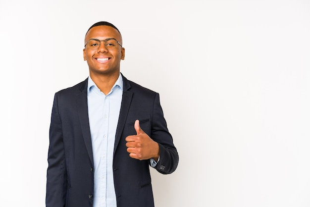 Young business latin man isolated on white space smiling and raising thumb up