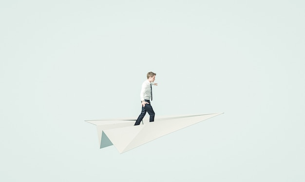 Young business man flies on a paper plane.