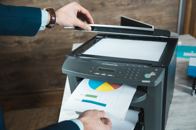 Young business man hand printer