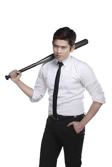 Young business man holding baseball bat