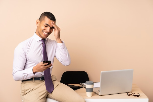 Young business man in a office laughing