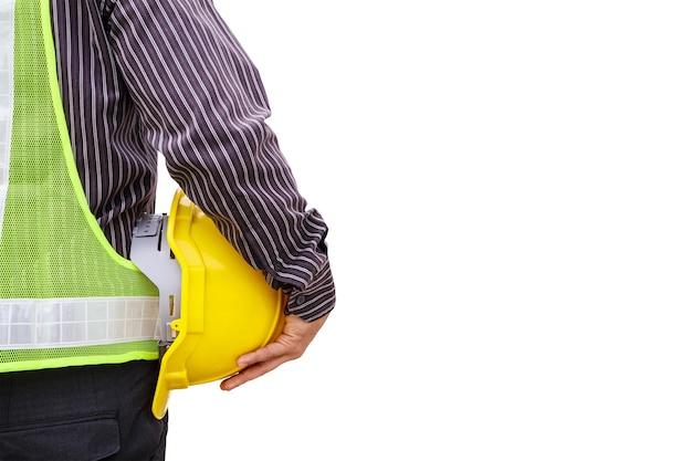 청사진 및 안전 헬멧 흰색 배경에 고립 된 젊은 비즈니스 남자 전문 엔지니어 작업자